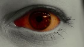 Horror scary eye close up. Horror scene of red eye, close up shot stock footage