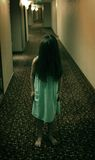 Horror scary little girl. Horror little girl kid in the hotel. Like the Ring movie or Grunge or another scary thriller movies Royalty Free Stock Photo