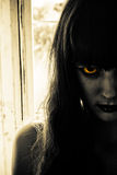 Horror scary woman. Closeup of female zombie face with colored eyes Royalty Free Stock Photo