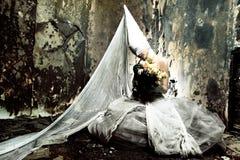 Horror scene. Shot of a twilight girl in white dress. Halloween, horror stock images