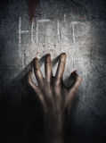 Horror Scene. Hand on wall backround. Poster, cover concept. Stock Photography