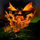 Horror Scene ~ Scary Jack O Lantern Pumkin Face An. D Twisted Dead Tree Roots Burning Inferno Hell Fire In The Evil Green Fog Of A Dark Stormy Night Royalty Free Stock Photography