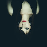 Horror Scene of a Woman Possessed, upside down Royalty Free Stock Image