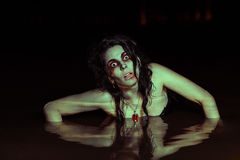 Horror Scene. The woman in the swamp Royalty Free Stock Photography