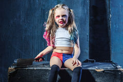Horror shot: a scary evil girl with bloody knife Royalty Free Stock Image