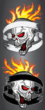 Horror shouting skull in fire flames twisted with old ribbon Royalty Free Stock Photo