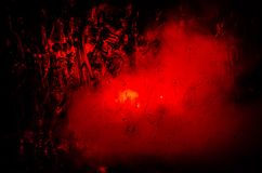 Horror silhouette behind the matte glass blood stain. Blurry hand and body figure abstraction. Background with fire. Selective focus Royalty Free Stock Photography