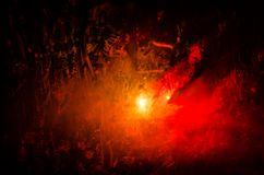 Horror silhouette behind the matte glass blood stain. Blurry hand and body figure abstraction. Background with fire. Selective focus Royalty Free Stock Photos