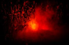 Horror silhouette behind the matte glass blood stain. Blurry hand and body figure abstraction. Background with fire. Selective focus Stock Images