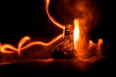 Horror silhouette of scary figure at night. Female demon. Demons coming. Slhouette of devil or monster figure on a background of. Fire. Horror view stock photo
