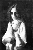 Horror style shot: mysterious ghost girl with moppet doll in hands. Grunge texture effect. Horror style shot: the mysterious ghost girl with moppet doll in hands Royalty Free Stock Image