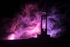 Horror view of Guillotine. Close-up of a guillotine on a dark foggy background. Execution concept stock images