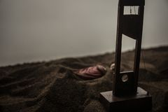Horror view of Guillotine. Close-up of a guillotine on a dark foggy background. Execution concept stock photo