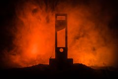 Horror view of Guillotine. Close-up of a guillotine on a dark foggy background. Execution concept stock image