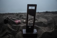 Horror view of Guillotine. Close-up of a guillotine on a dark foggy background. Execution concept stock photography