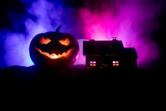 Horror view of Halloween pumpkin with scary smiling face. Head jack lantern with spooky building. Horror view of Halloween pumpkin with scary smiling face. Head royalty free stock photos