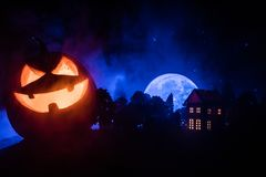 Horror view of Halloween pumpkin with scary smiling face. Head jack lantern with spooky building. Horror view of Halloween pumpkin with scary smiling face. Head stock photography