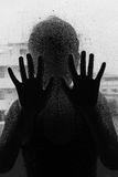 Horror woman behind the matte glass ,style  black and white, Blurry hand and body Stock Image
