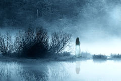 Mysterious woman ghost in blue mist Royalty Free Stock Photography