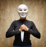 Woman in white mask holding the knife Stock Photography