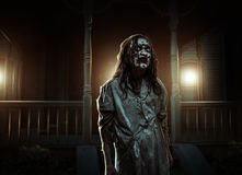 Horror zombie near the abandoned house. Halloween. Zombie girl near the abandoned house. Horror. Halloween royalty free stock photography