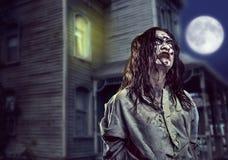 Horror zombie near the abandoned house. Halloween. Stock Photo