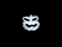 Horrormaske auf schwarzem Hintergrund Stockbild
