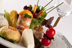 Hors d`oeuvre, A delicious selection of cold meats, cheeses, con Stock Photography