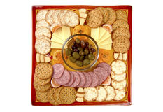 Hors D'oeuvre Tray. Snacks on a handmade platter that has curved edges. Focus = the olive group. 12MP camera Stock Photo