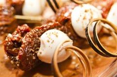Hors-d'oeuvres savoureux avec des tomates Photo stock