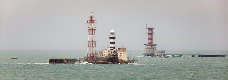 Horsburgh Lighthouse and Abu Bakar Maritime Base. Horsburgh Lighthouse on Pedra Branca Island of Singapore and Abu Bakar Maritime Base owned by Malaysia in the Stock Photos