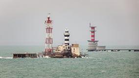 Horsburgh Lighthouse and Abu Bakar Maritime Base. Horsburgh Lighthouse on Pedra Branca Island of Singapore and Abu Bakar Maritime Base owned by Malaysia in the stock photography