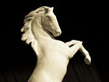 Horse. Sculpture of the horse, getting up on racks, moulded manually Royalty Free Stock Photo