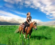 Horse. A beautiful woman riding a horse Stock Photo