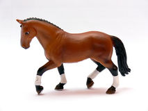 Horse. Close up of the plastic brown toy horse isolated on white background royalty free stock photos