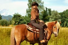 Horse. A woman riding horse in countryside Royalty Free Stock Photos