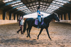 Horse arena with riders Royalty Free Stock Photo