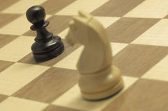 Horse Attack. Chess game with focus on pawn royalty free stock image