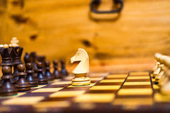 Horse is attacking the pawn in chess Royalty Free Stock Photo