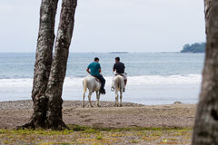 Horse back riding on the beach Royalty Free Stock Image