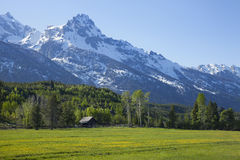 Horse barn below Grand Tetons range. A horse barn sits below the Grand Tetons range in Wyoming stock images