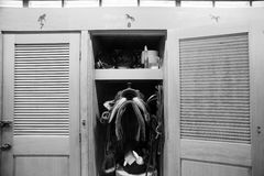 Horse Barn Gear Closet Racing Stable Paddock Tack Saddle. A rider keeps gear close to her horse in this tack closet royalty free stock photography