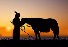 With horse Blurred. Native American standing next to a horse behind a blurred background Stock Photo