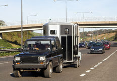 Horse-Box. Leading the traffic on a busy highway Stock Photography