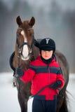 Horse and boy - child riding horseback. Chestnut horse and small boy - child riding Welsh pony Stock Images