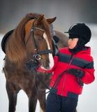 Horse and boy - child riding horseback. Chestnut horse and small boy - child riding Welsh pony Stock Photo