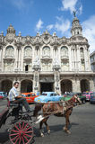 Horse and Buggy with Vintage American Cars Havana Cuba Royalty Free Stock Image