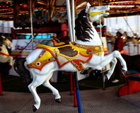 Horse carousel. A wooden horse on a moving carousel at the Calgary Stampede Stock Photos