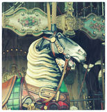 Horse in a carousel Stock Images