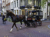 Horse and carriage in Amsterdam Stock Photo